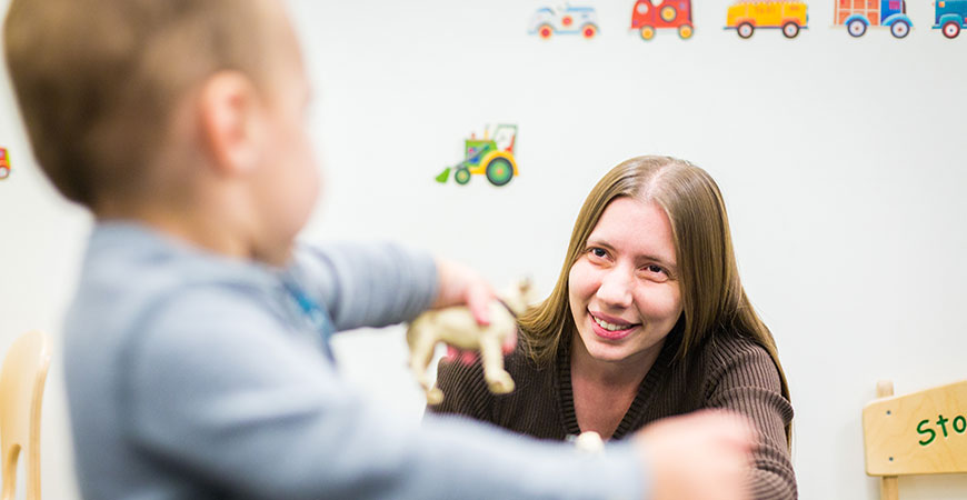 Rose Scott engages with a child to gauge his reactions as part of her research.